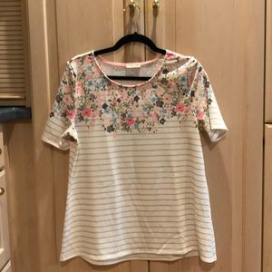 Olive striped tee with floral pattern.